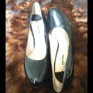 Miu Miu Black Patent Leather Platform Pump Heels.